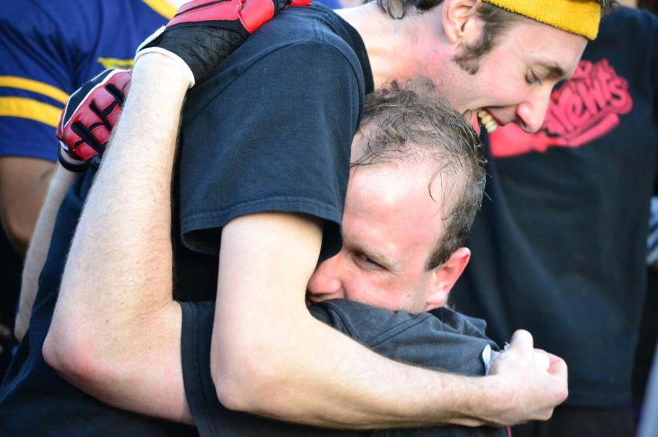 Co-captains Sam Fischgrund and Kevin Oelze of the Skrewts embrace just after their tournament win.  The two combined for all 70 of their points in the final match. Credit: Laurel Haspert