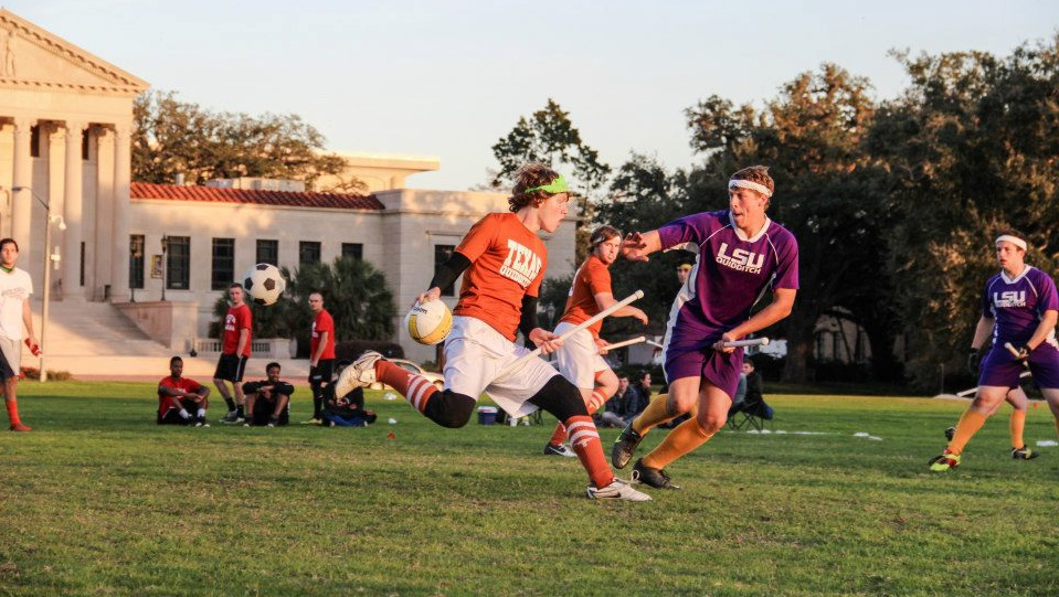 Stephen Bell (Texas) is defended by Jake Smith (LSU) shortly before being sniped by a bludger (Photo Lauren Carter)